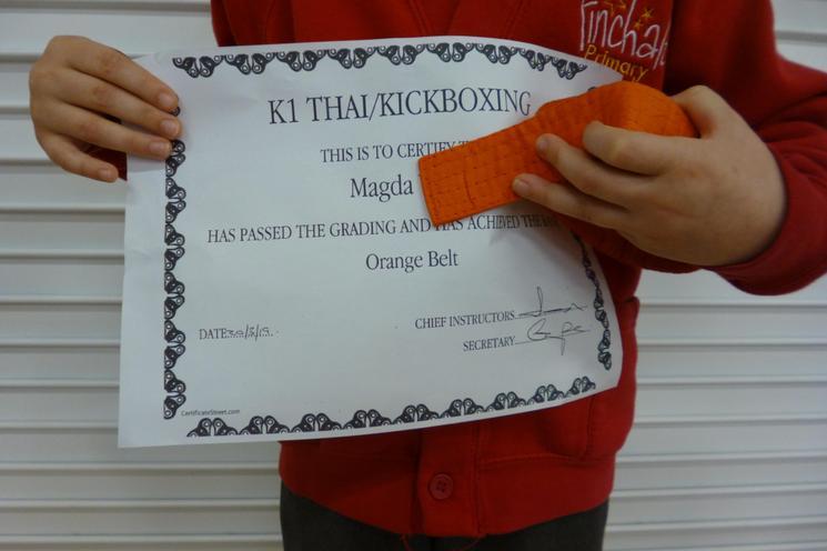 Passed her grading, achieved her orange belt
