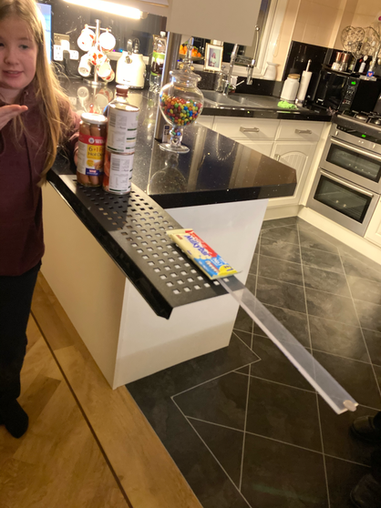 Alexa and Theo used kitchen items and a ruler.