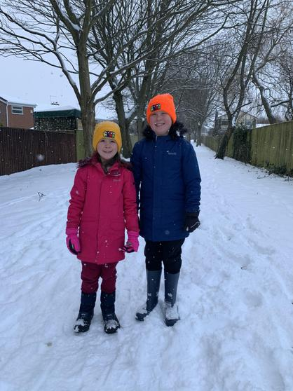 Adam enjoying exercise in the snow with his sister