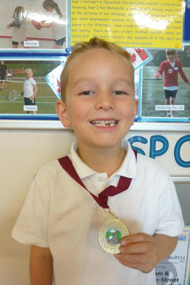 W, Y2, cycled 3 miles to win his medal.