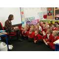 This is Year 1 singing a song called The Rainbow.