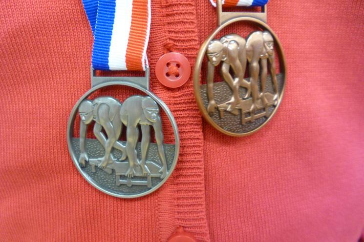 Silver 200m back stroke, bronze 100m breast stroke