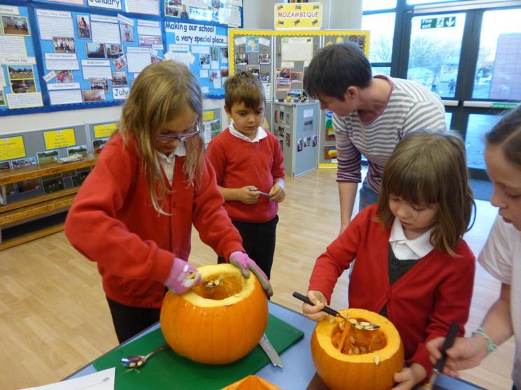 Carving a pumpkin.