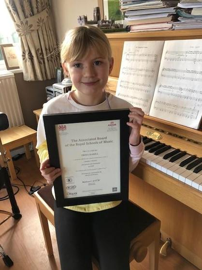Freya achieved a Distinction for her Grade 1 piano exam - well done!