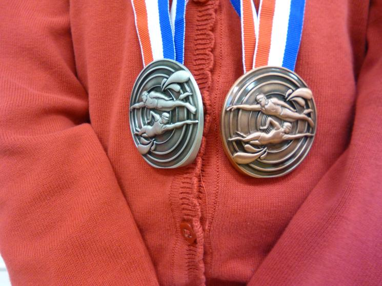 A silver for 100m breast & bronze for 100m free.