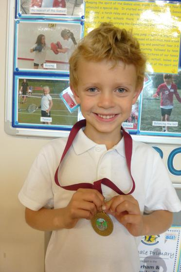 R,  Y2, cycled 3 miles to win his medal.