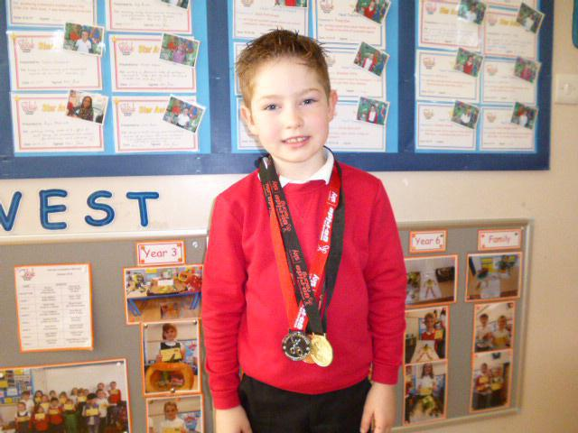 H Y2 with cycling medals.