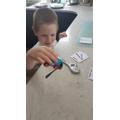 Ivon investigating magnets.