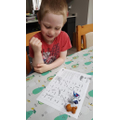 Ivon enjoying the snakes and ladders game.