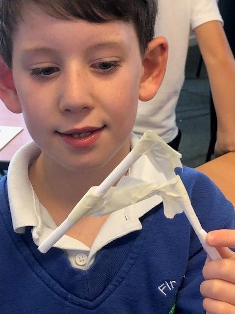 Using masking tape to join pieces together.