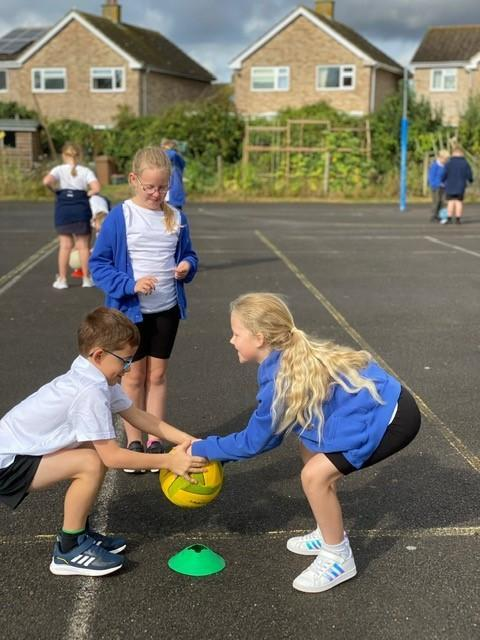 BALL! Grab the ball quickly using finger tips and thumb, pull the ball into your chest!