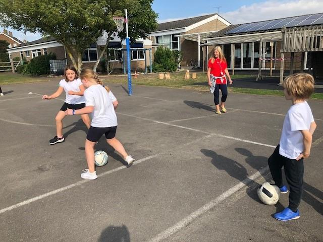 We practised the skills of both attacking and defending in a game.