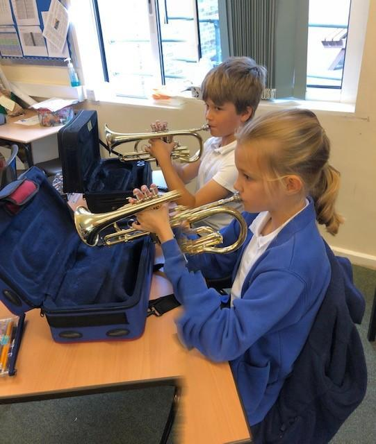 Learning how to hold the cornets correctly and sitting with good posture for playing.
