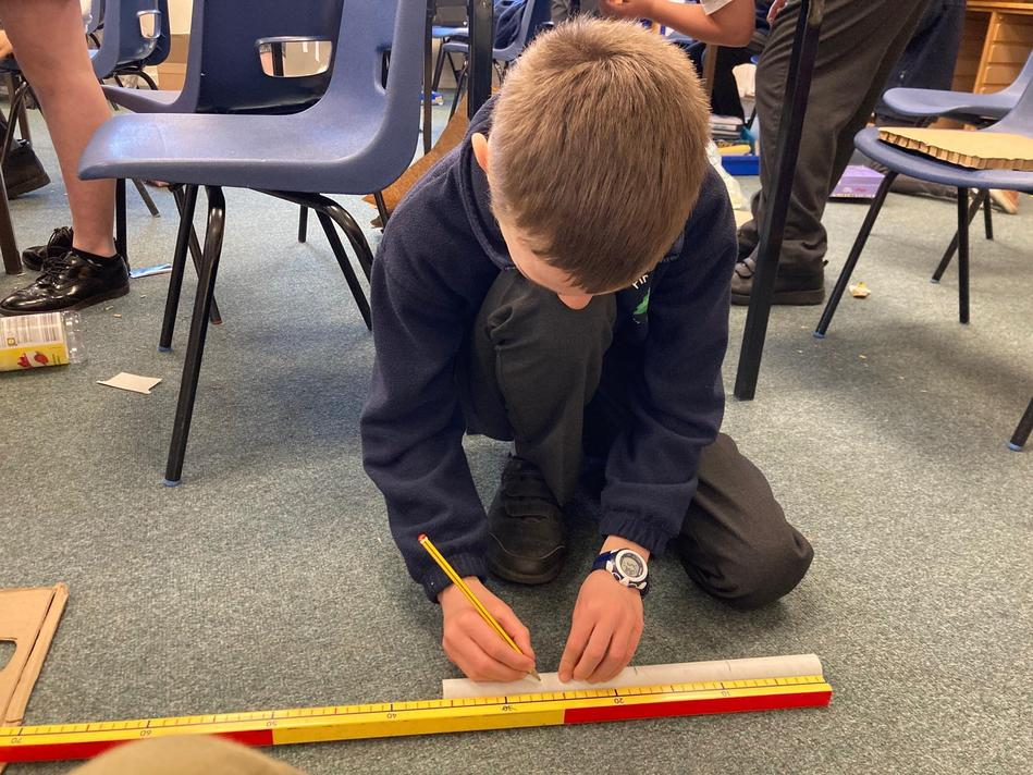 Using our division and measuring skills to create equal lengths for the legs