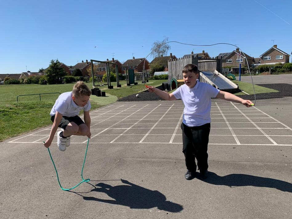 Having fun in the sun developing skipping skills!