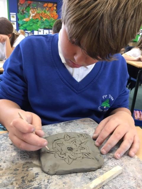 Carving our Tudor Roses into clay
