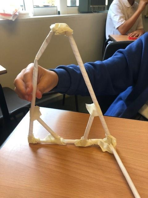Creating triangle shapes in the corners to strengthen and maintain the shape.