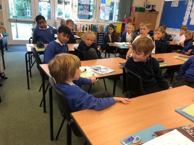 Rhetorical questions, emotive language and boastful vocabulary were used.