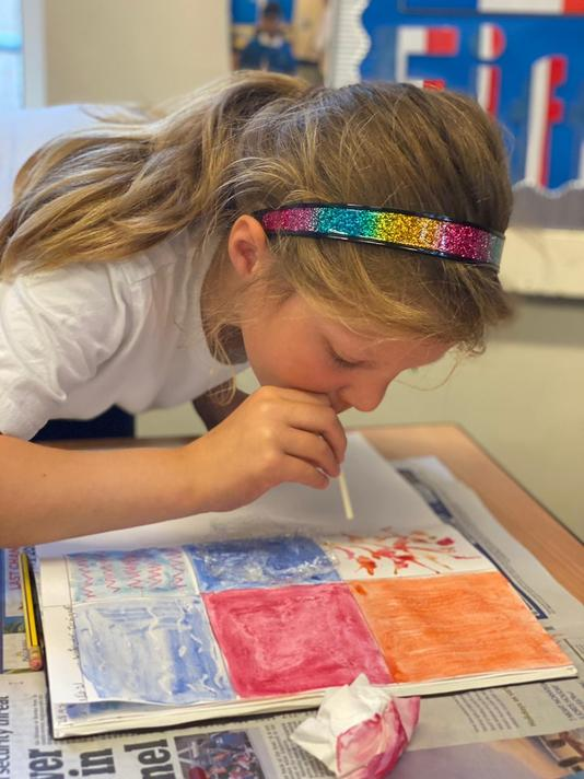 Different effects -  wax resist with candle and coloured wax crayons,