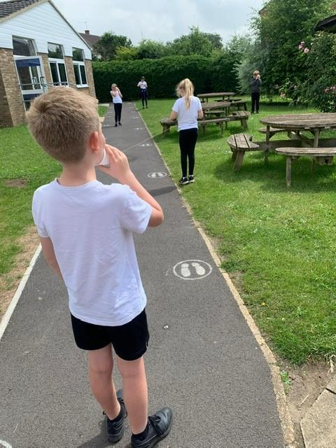 We made telephones with kite string and paper cups.
