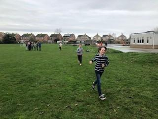 Running clockwise around the track to reach our class target.