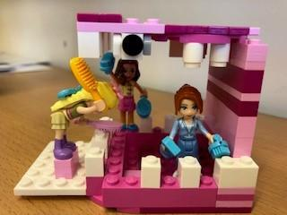 Sophie's Lego model of teeth being cleaned. Can you spot the decay?