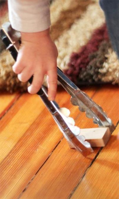 Use tongs to pick up and move small objects.