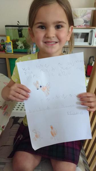 Erika draws a fox and cub she has spotted.