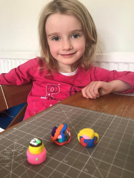 Poppy makes cakes from modelling clay.