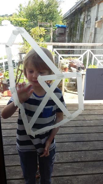 Martha makes a spider web.