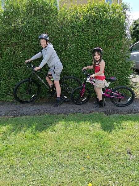 Olivia goes on a bike ride with her brother.