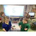 "Nursery Children making 'Silly Soup"" with items beginning with s."