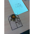 Designing stained glass decoartions for our class reflection area