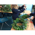 Working in pairs to create advent wreaths for each class
