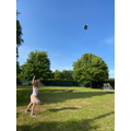 L flying a kite on a windy day