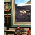 Adding our stained glass designs to our class reflection area.