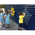 Using the giant weaving frames at play time
