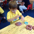 Using playdough to make shapes