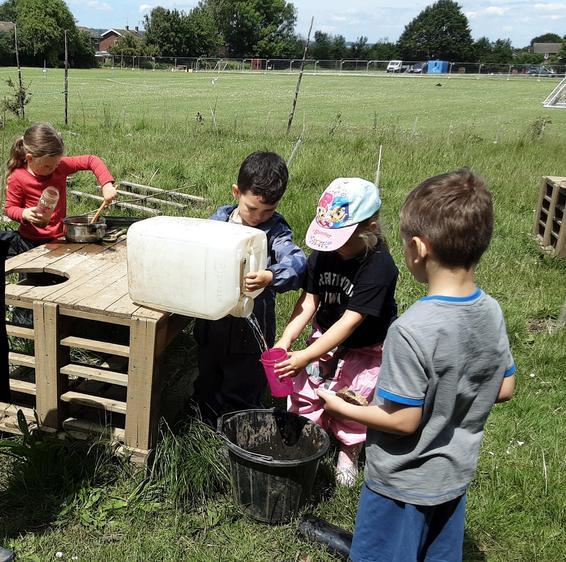 Teamwork in the mud kitchen