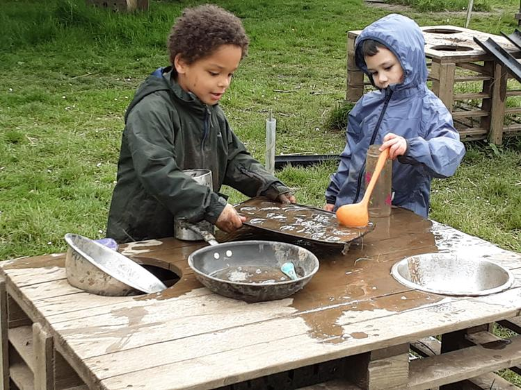 Making cakes in the mud kitchen