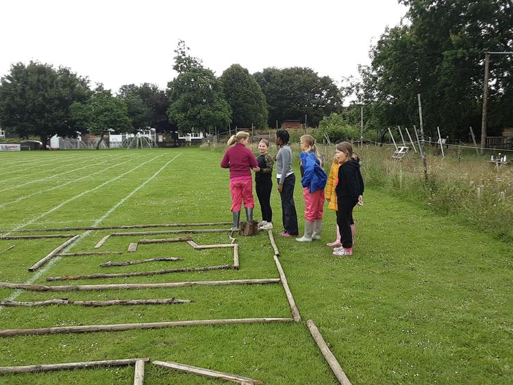Working as a team to guide each other through the maze