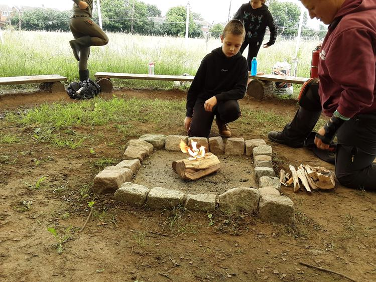 Learning how to safely start a campfire