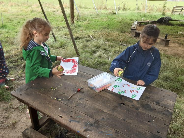 Using apples that grow on site the children apple printed