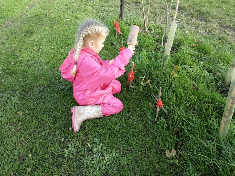 Using a mallet to place our poppies onsite for remembrance day