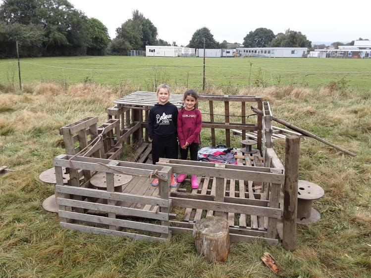 These two worked really hard to create their den