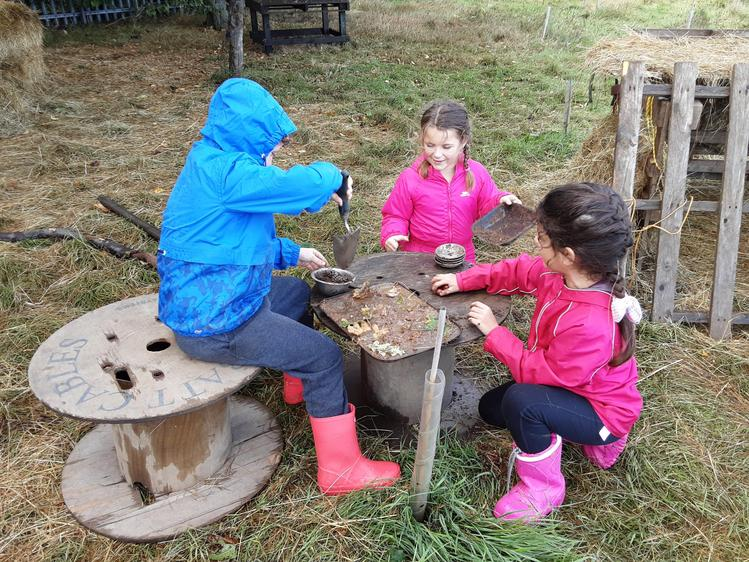 Making mud pies to sell in the shop