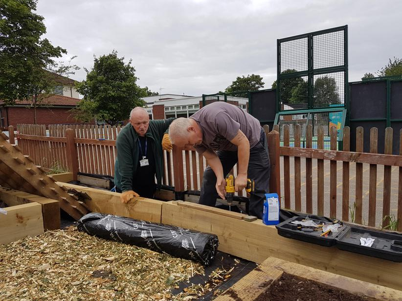 Mr Murphy & Mr Strode constructing the raised beds