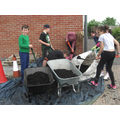 Poplar Class filling the bed with recycled compost