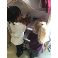 Playing in the dolls house.