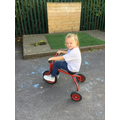 Riding the bikes in the garden.